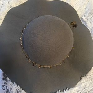 Adorable blue-grayish hat with charm